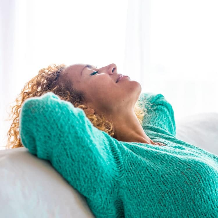 Woman in Teal Relaxing